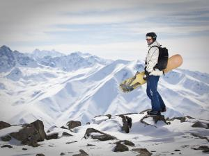A Snowboarder at the Summit of Mount Affawat in Gulmarg, Kashmir, India by Julian Love