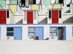 Beach Huts on Tolcarne Beach, Newquay, Cornwall, England by Julian Love