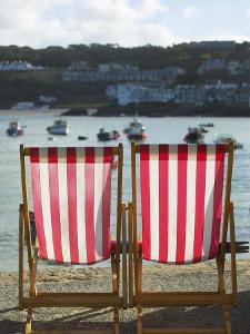 Deckchairs, the Symbol of British Tourism, on the Quayside of St Ives, Cornwall by Julian Love
