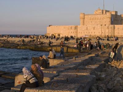Friends and Couples Gather at Sunset Outside the Citadel of Quatbai, Alexandria, Egypt by Julian Love