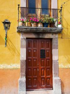 Carved Wooden Door and Balcony, San Miguel, Guanajuato State, Mexico by Julie Eggers