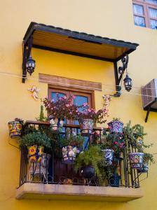 Decorative Pots on Window Balcony, Guanajuato, Mexico by Julie Eggers