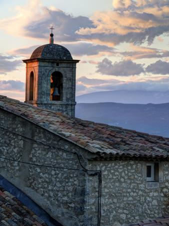 France, Provence, Lacoste. Church Bell Tower at Sunset in the Hill Town of Lacoste