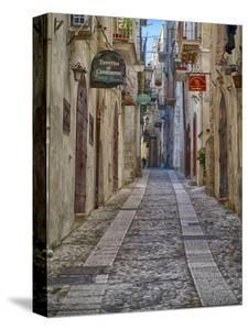 Italy, Apulia, Foggia, Vieste. A picturesque alley in Vieste old town. by Julie Eggers