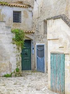 Italy, Basilicata, Matera. Doors in a courtyard in the old town of Matera. by Julie Eggers