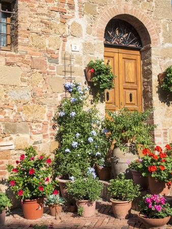 Italy, Tuscany. Flowers by House in the Medieval Town Monticchiello