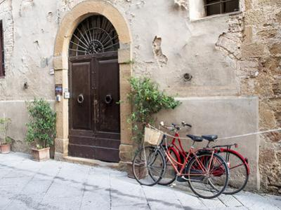 Italy, Tuscany, Pienza. Bicycles Parked Along the Streets of Pienza