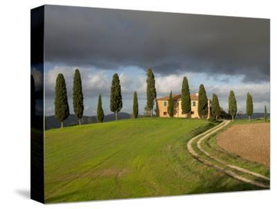 Italy, Tuscany, Pienza. Tuscan Farmhouse with Stormy Clouds