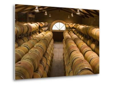 Oak Barrels in Wine Cellar at Groth Winery in Napa Valley, California, USA by Julie Eggers