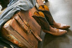 Cowboy Snakeskin Boots and an Antique Suitcase, Santa Fe, New Mexico by Julien McRoberts
