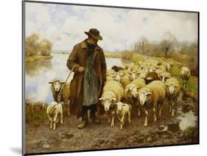 A Shepherd and Sheep by a Lake by Julius Hugo Bergmann