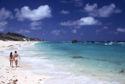 https://imgc.artprintimages.com/img/print/july-1973-couple-walking-on-the-beach-bermuda_u-l-q130y5k0.jpg?p=0