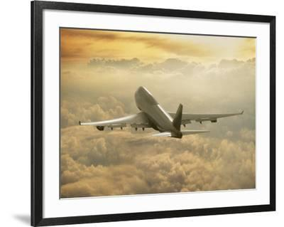 Jumbo Jet Above Clouds at 35,000 Feet-Peter Walton-Framed Photographic Print