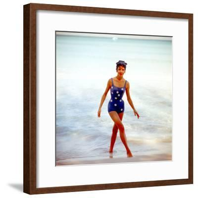 June 1956: Woman in Polka-Dot Swimsuit Modeling Beach Fashions in Cuba-Gordon Parks-Framed Premium Photographic Print