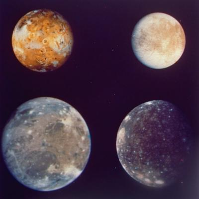 Jupiter's Satellites Io, Europa, Ganymede and Callisto as Depicted by Voyager 1 Spacecraft--Photographic Print