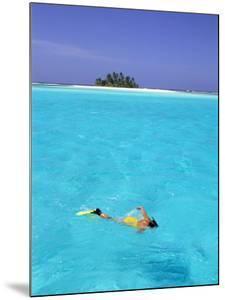 Woman Snorkelling at Sea Surface,Cocos Keeling Island in Background, Indian Ocean, Australia by Jurgen Freund