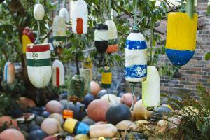 Collection Of Old Crab Buoys In Yard by Justin Bailie