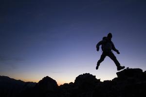 Man Exploring Mt. Rainier National Park, WA by Justin Bailie