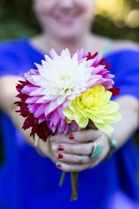 Young Woman Holding Flowers by Justin Bailie