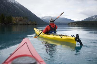 Young Woman Kayaking on Chilko Lake in British Columbia, Canada