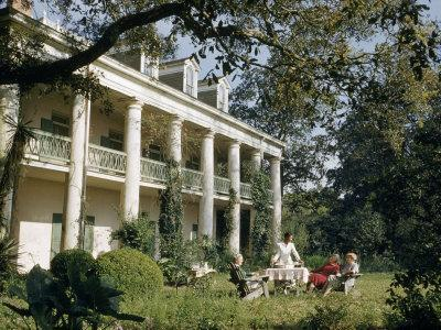 Servant Brings Tea to Women Seated on Lawn Outside Plantation House