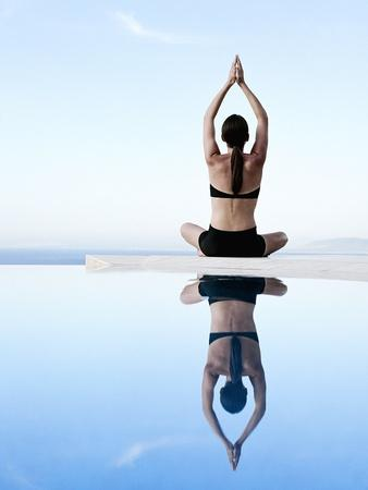 Woman Exercising on Swimming Pool Edge