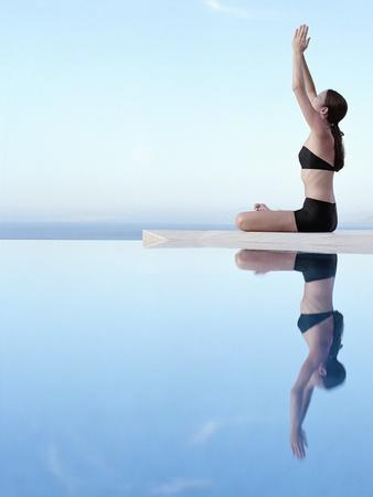 Woman Exercising on Swimming Pool Edge