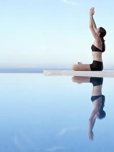 Woman Exercising on Swimming Pool Edge by Jutta Klee