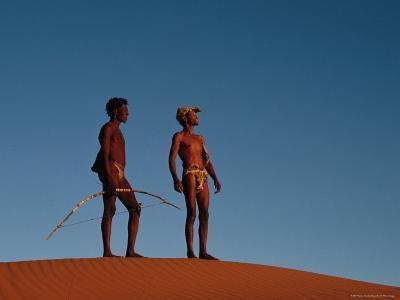 Kalahari Bushmen Standing on Sand Hill, South Africa-Ariadne Van Zandbergen-Photographic Print