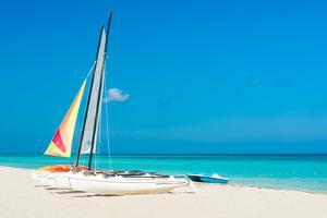 Colorful Sailing Boats for Rent on a Sunny Day at Varadero Beach in Cuba by Kamira