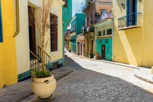 Narrow Street Sidelined by Colorful Buildings in Old Havana by Kamira
