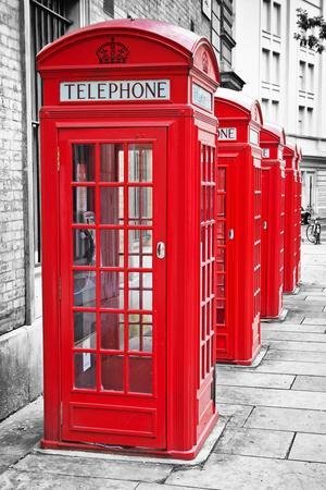 Row Of Iconic London Red Phone Cabins With The Rest Of The Picture In Black And White