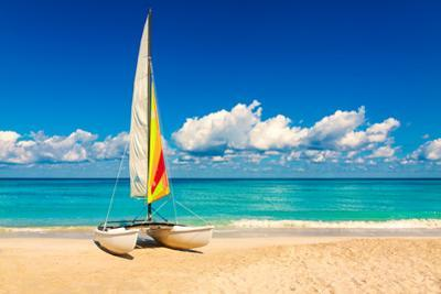 Sailing Boat on a Beautiful Summer Day at Beach in Cuba by Kamira