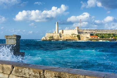 The Famous Castle of El Morro in Havana with a Stormy Weather and Big Waves in the Ocean by Kamira