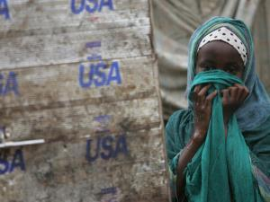 A Somali Child Covers Her Face at Dadaab Refugee Camp in Northern Kenya Monday, August 7 2006 by Karel Prinsloo