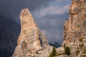 Adventure seeker high wire walking in Cinque Torri, Belluno, Dolomites, Italy by Karen Deakin
