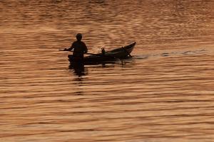A Fisherman on the Hoi an River at Daybreak by Karen Kasmauski