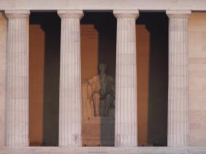 A View of Lincolns Statue Behind Columns at the Lincoln Memorial by Karen Kasmauski