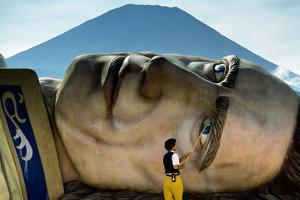 A worker at the defunct 'Gulliver's Travels' theme park scrubs the giant head of Gulliver by Karen Kasmauski