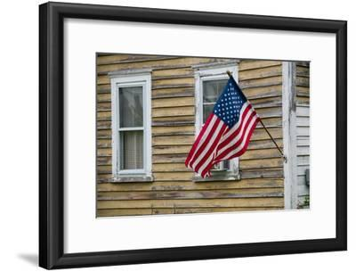 An American Flag Hangs from a House in Tylerton