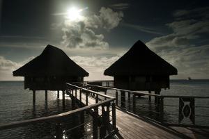 Cottages Above the Lagoon on the Island of Bora Bora by Karen Kasmauski