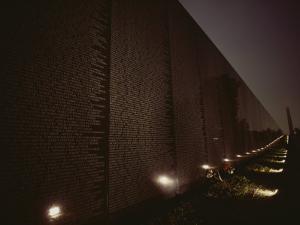 Small Lights Illuminate the Path at the Vietnam Veterans Memorial by Karen Kasmauski