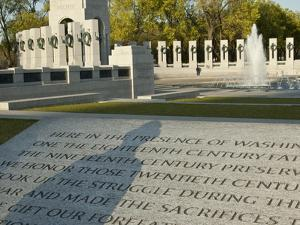 The World War II Memorial with the Shadow of a WWII Veteran by Karen Kasmauski