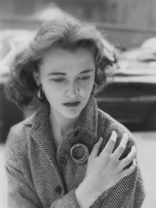 Vogue - August 1953 - Woman on Street Clutching Herself by Karen Radkai