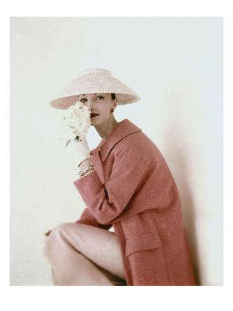 Vogue - March 1956 - Model Evelyn Tripp wearing pink ensemble