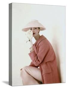 Vogue - March 1956 - Model Evelyn Tripp wearing pink ensemble by Karen Radkai