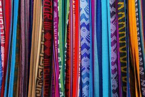 Cloths, Blankets, Scarves, and Hammocks Hang on Display at the Otavalo Market, in Otavalo, Ecuador by Karine Aigner