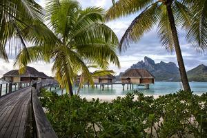 Mount Otemanu In The Distance Of The Over Water Bungalows At The Four Seasons Bora Bora by Karine Aigner