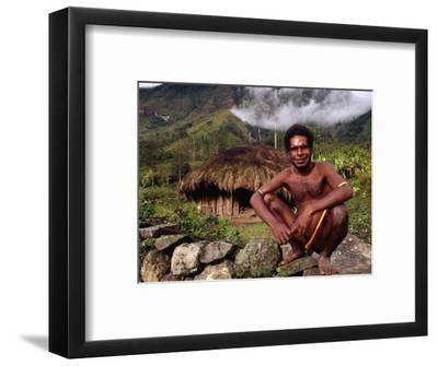 Dani Man in Front of His House Near the Baliem Gorge, Tangma, Irian Jaya, Indonesia