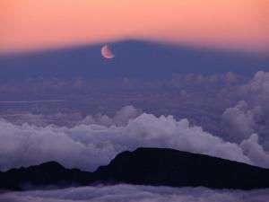 Lunar Eclipse at Sunset with a Moonrise from Summit of Mt. Haleakala, Haleakala NP, Maui, Hawaii by Karl Lehmann